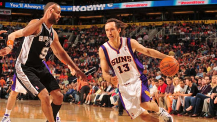 PHOENIX, AZ – APRIL 13: Steve Nash #13 of the Phoenix Suns drives against Tony Parker #9 of the San Antonio Spurs in an NBA game played on April 13, 2011 at U.S. Airways Center in Phoenix, Arizona. NOTE TO USER: User expressly acknowledges and agrees that, by downloading and or using this Photograph, user is consenting to the terms and conditions of the Getty Images License Agreement. Mandatory Copyright Notice: Copyright 2011 NBAE (Photo by Barry Gossage/NBAE via Getty Images)