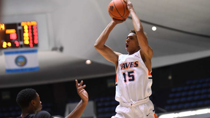 ANAHEIM, CA – DECEMBER 01: Emmitt Holt #15 of the Providence Friars defends Kessler Edwards #15 of the Pepperdine Waves as he takes a shot in the first half of the game during the Wooden Legacy at the Anaheim Convention Center on December 1, 2019, in Anaheim, California. (Photo by Jayne Kamin-Oncea/Getty Images)