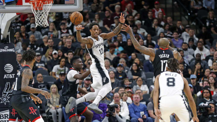 San Antonio Spurs wing DeMar DeRozan #10 passes out of a shot while defended by PJ Tucker #17 of the Houston Rockets in a matchup at the AT&T Center in San Antonio, TX (Photo by Ronald Cortes/Getty Images)