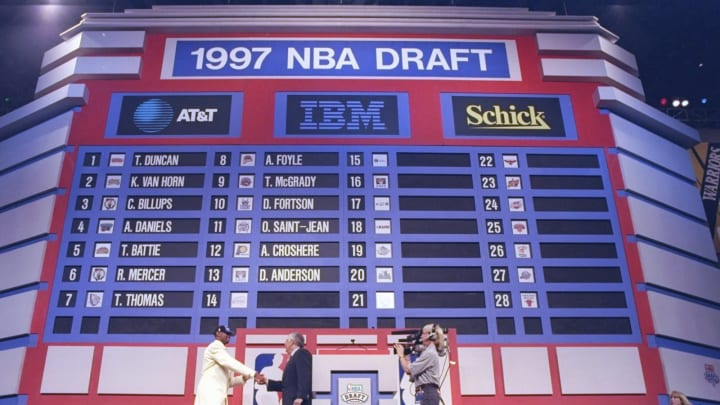 25 Jun 1997: Derek Anderson of the Cleveland Cavaliers shakes hands with NBA Commissioner David Stern during the NBA Draft at the Charlotte Coliseum in Charlotte, North Carolina.