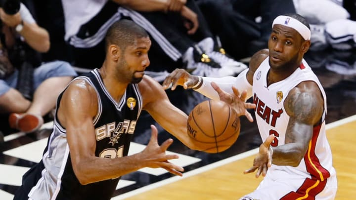 MIAMI, FL - JUNE 20: Tim Duncan #21 of the San Antonio Spurs against LeBron James #6 of the Miami Heat during Game Seven of the 2013 NBA Finals at AmericanAirlines Arena on June 20, 2013 in Miami, Florida. (Photo by Kevin C. Cox/Getty Images)