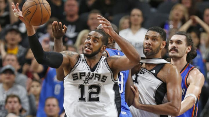 SAN ANTONIO,TX - MAY 2: LaMarcus Aldridge #12 of the San Antonio Spurs grabs a rebound against the Oklahoma City Thunder during game Two of the Western Conference Semifinals for the 2016 NBA Playoffs at AT&T Center on May 2, 2016 in San Antonio, Texas. NOTE TO USER: User expressly acknowledges and agrees that , by downloading and or using this photograph, User is consenting to the terms and conditions of the Getty Images License Agreement. (Photo by Ronald Cortes/Getty Images)