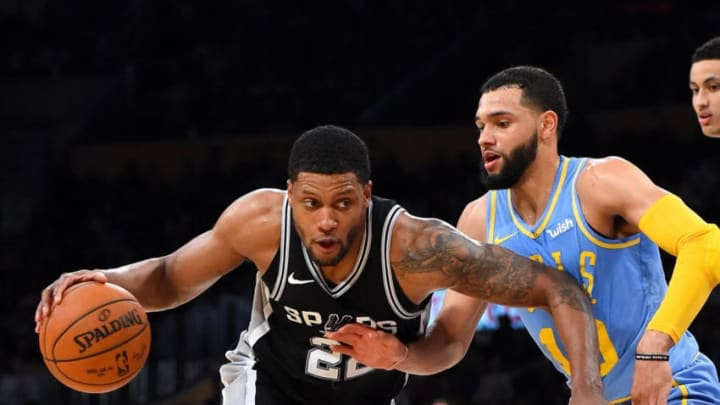 LOS ANGELES, CA - APRIL 04: Tyler Ennis #10 of the Los Angeles Lakers defends Rudy Gay #22 of the San Antonio Spurs as he drives to the basket in the second half of the game at Staples Center on April 4, 2018 in Los Angeles, California. NOTE TO USER: User expressly acknowledges and agrees that, by downloading and or using this photograph, User is consenting to the terms and conditions of the Getty Images License Agreement. (Photo by Jayne Kamin-Oncea/Getty Images)