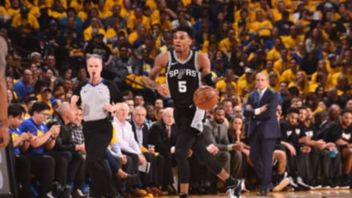 OAKLAND, CA – APRIL 24: Dejounte Murray #5 of the San Antonio Spurs handles the ball against the Golden State Warriors Game Five of Round One of the 2018 NBA Playoffs on April 24, 2018 at ORACLE Arena in Oakland, California. NOTE TO USER: User expressly acknowledges and agrees that, by downloading and or using this photograph, user is consenting to the terms and conditions of Getty Images License Agreement. Mandatory Copyright Notice: Copyright 2018 NBAE (Photo by Noah Graham/NBAE via Getty Images)