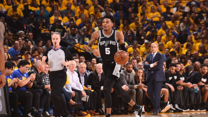 OAKLAND, CA – APRIL 24: Dejounte Murray #5 of the San Antonio Spurs handles the ball against the Golden State Warriors Game Five of Round One of the 2018 NBA Playoffs on April 24, 2018 at ORACLE Arena in Oakland, California.