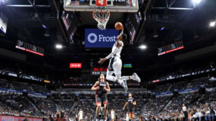 SAN ANTONIO, TX – SEPTEMBER 30: Dejounte Murray #5 of the San Antonio Spurs dunks the ball against the Miami Heat during a pre-season game on September 30, 2018 at the AT&T Center in San Antonio, Texas. NOTE TO USER: User expressly acknowledges and agrees that, by downloading and or using this photograph, user is consenting to the terms and conditions of the Getty Images License Agreement. Mandatory Copyright Notice: Copyright 2018 NBAE (Photos by Mark Sobhani/NBAE via Getty Images)