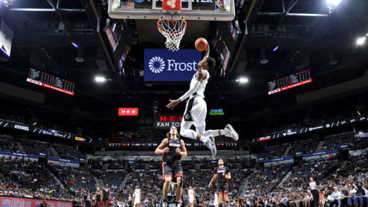 SAN ANTONIO, TX - SEPTEMBER 30: Dejounte Murray #5 of the San Antonio Spurs dunks the ball against the Miami Heat during a pre-season game on September 30, 2018 at the AT&T Center in San Antonio, Texas. NOTE TO USER: User expressly acknowledges and agrees that, by downloading and or using this photograph, user is consenting to the terms and conditions of the Getty Images License Agreement. Mandatory Copyright Notice: Copyright 2018 NBAE (Photos by Mark Sobhani/NBAE via Getty Images)