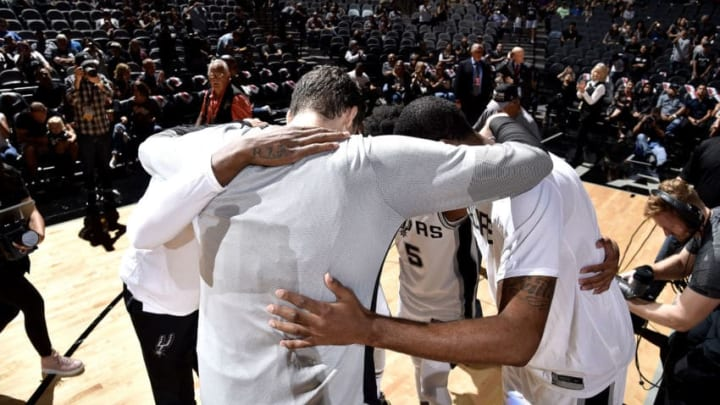 SAN ANTONIO, TX - SEPTEMBER 30: The San Antonio Spurs huddle up before the game against the Miami Heat on September 30, 2018 at the AT&T Center in San Antonio, Texas. NOTE TO USER: User expressly acknowledges and agrees that, by downloading and/or using this Photograph, user is consenting to the terms and conditions of the Getty Images License Agreement. Mandatory Copyright Notice: Copyright 2018 NBAE (Photo by Bill Baptist/NBAE via Getty Images)