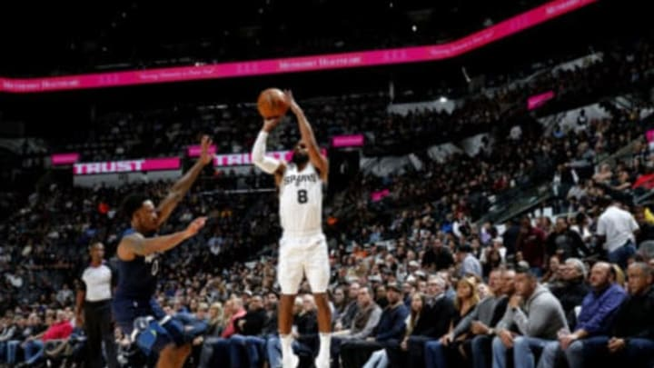 Patty Mills of the San Antonio Spurs shoots the ball over Minnesota's Jeff Teague (Photos by Chris Covatta/NBAE via Getty Images)