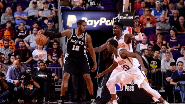 PHOENIX, AZ - OCTOBER 31: LaMarcus Aldridge #12 of the San Antonio Spurs handles the ball against the Phoenix Suns on October 31, 2018 at Talking Stick Resort Arena in Phoenix, Arizona. NOTE TO USER: User expressly acknowledges and agrees that, by downloading and or using this photograph, user is consenting to the terms and conditions of the Getty Images License Agreement. Mandatory Copyright Notice: Copyright 2018 NBAE (Photo by Michael Gonzales/NBAE via Getty Images)