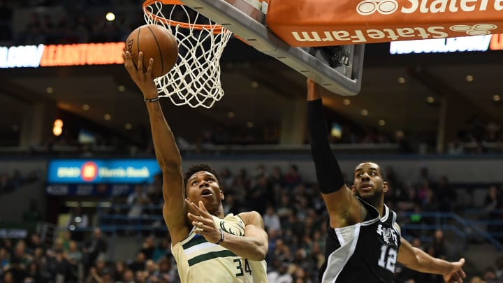 MILWAUKEE, WI – MARCH 25: Giannis Antetokounmpo #34 of the Milwaukee Bucks drives to the basket against LaMarcus Aldridge #12 of the San Antonio Spurs during the second half of a game (Photo by Stacy Revere/Getty Images)