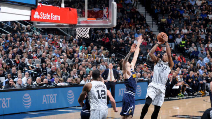 SAN ANTONIO, TX - DECEMBER 26: DeMar DeRozan #10 of the San Antonio Spurs shoots the ball against the Denver Nuggets on December 26, 2018 at the AT&T Center in San Antonio, Texas. NOTE TO USER: User expressly acknowledges and agrees that, by downloading and/or using this photograph, user is consenting to the terms and conditions of the Getty Images License Agreement. Mandatory Copyright Notice: Copyright 2018 NBAE (Photo by Mark Sobhani/NBAE via Getty Images)