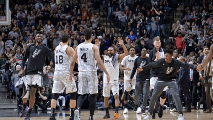 SAN ANTONIO, TX - DECEMBER 26: The San Antonio Spurs celebrate during the game against the Denver Nuggets on December 26, 2018 at the AT&T Center in San Antonio, Texas. NOTE TO USER: User expressly acknowledges and agrees that, by downloading and/or using this photograph, user is consenting to the terms and conditions of the Getty Images License Agreement. Mandatory Copyright Notice: Copyright 2018 NBAE (Photo by Mark Sobhani/NBAE via Getty Images)