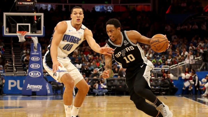 ORLANDO, FLORIDA – DECEMBER 19: DeMar DeRozan #10 of the San Antonio Spurs drives against Aaron Gordon #00 of the Orlando Magic during the game at Amway Center (Photo by Sam Greenwood/Getty Images)
