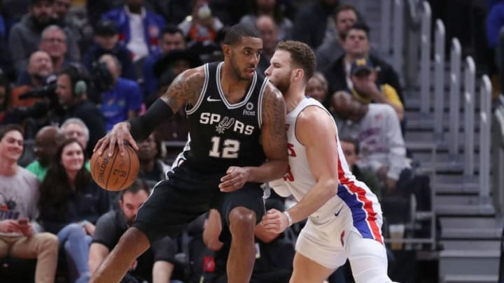 DETROIT, MI - JANUARY 7: LaMarcus Aldridge #12 of the San Antonio Spurs looks to drive the ball as Blake Griffin #23 of the Detroit Pistons defends during the second quarter of the game at Little Caesars Arena on January 7, 2019 in Detroit, Michigan. NOTE TO USER: User expressly acknowledges and agrees that, by downloading and or using this photograph, User is consenting to the terms and conditions of the Getty Images License Agreement (Photo by Leon Halip/Getty Images)