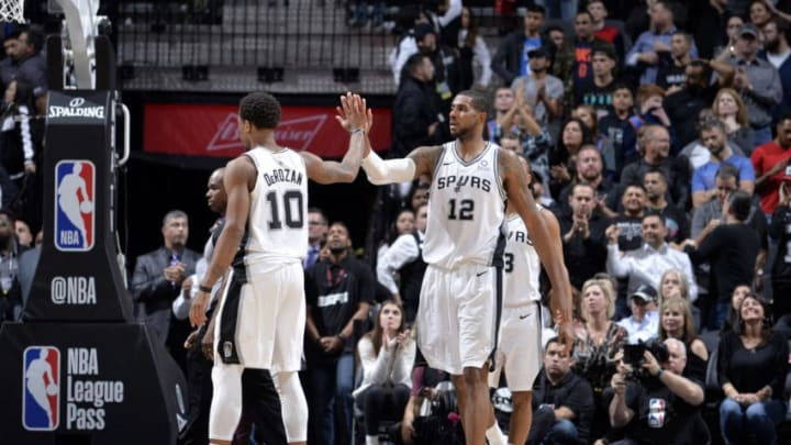 SAN ANTONIO, TX - JANUARY 10: LaMarcus Aldridge #12 of the San Antonio Spurs hi-fives DeMar DeRozan #10 of the San Antonio Spurs during the game against the Oklahoma City Thunder on January 10, 2019 at the AT&T Center in San Antonio, Texas. NOTE TO USER: User expressly acknowledges and agrees that, by downloading and or using this photograph, user is consenting to the terms and conditions of the Getty Images License Agreement. Mandatory Copyright Notice: Copyright 2019 NBAE (Photos by Mark Sobhani/NBAE via Getty Images)