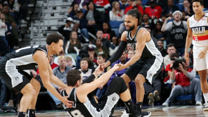 NEW ORLEANS, LA - JANUARY 26: Patty Mills #8 assist Marco Belinelli #18 of the San Antonio Spurs off the floor during the game against the New Orleans Pelicans on January 26, 2019 at the Smoothie King Center in New Orleans, Louisiana. NOTE TO USER: User expressly acknowledges and agrees that, by downloading and or using this Photograph, user is consenting to the terms and conditions of the Getty Images License Agreement. Mandatory Copyright Notice: Copyright 2019 NBAE (Photo by Layne Murdoch Jr./NBAE via Getty Images)