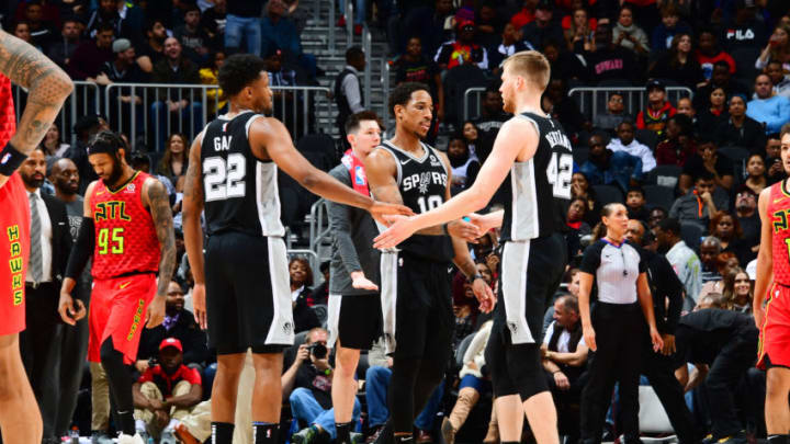 ATLANTA, GA - MARCH 6: Rudy Gay #22 DeMar DeRozan #10 and Davis Bertans #42 of the San Antonio Spurs high five against the Atlanta Hawks on March 6, 2019 at State Farm Arena in Atlanta, Georgia. NOTE TO USER: User expressly acknowledges and agrees that, by downloading and/or using this Photograph, user is consenting to the terms and conditions of the Getty Images License Agreement. Mandatory Copyright Notice: Copyright 2019 NBAE (Photo by Scott Cunningham/NBAE via Getty Images)