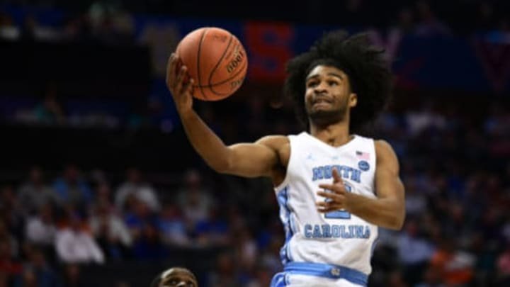 CHARLOTTE, NC – MARCH 14: NBA Draft prospect Coby White (2) shoots a runner during the ACC basketball tournament between the Louisville Cardinals and the North Carolina Tar Heels on March 14, 2019, at the Spectrum Center in Charlotte, NC. (Photo by William Howard/Icon Sportswire via Getty Images)