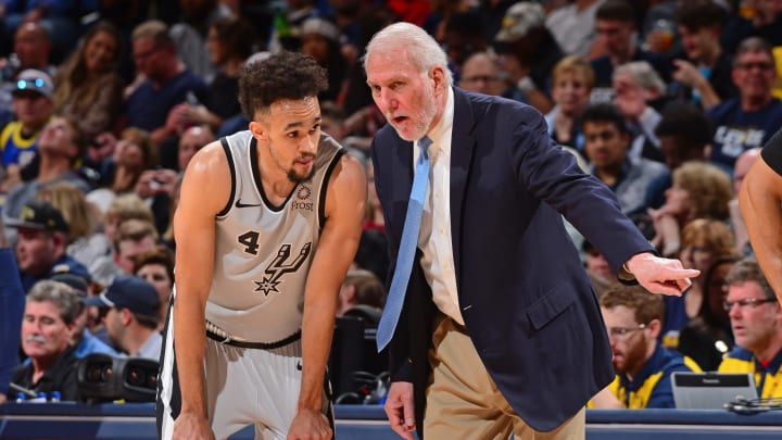 DENVER, CO – APRIL 27: Derrick White #4, and Head Coach Gregg Popovich of the San Antonio Spurs talk during Game Seven of Round One of the 2019 NBA Playoffs against the Denver Nuggets on April 27, 2019 at the Pepsi Center in Denver, Colorado. (Photo by Bart Young/NBAE via Getty Images)