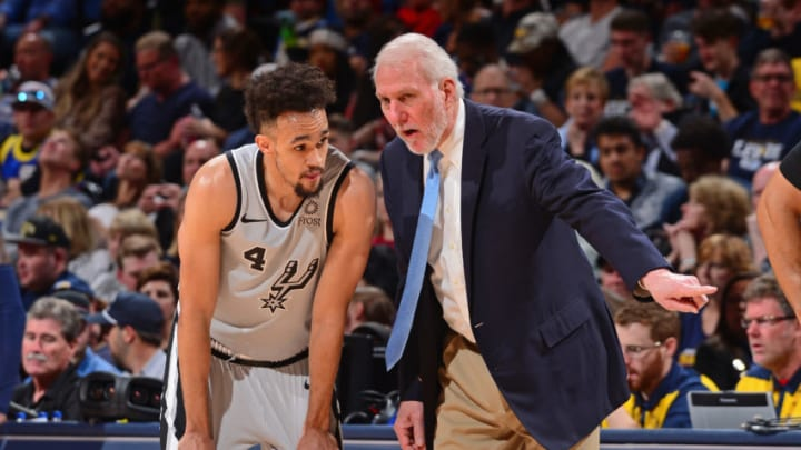 DENVER, CO - APRIL 27: Derrick White #4, and Head Coach Gregg Popovich of the San Antonio Spurs talk during Game Seven of Round One of the 2019 NBA Playoffs against the Denver Nuggets on April 27, 2019 at the Pepsi Center in Denver, Colorado. NOTE TO USER: User expressly acknowledges and agrees that, by downloading and/or using this Photograph, user is consenting to the terms and conditions of the Getty Images License Agreement. Mandatory Copyright Notice: Copyright 2019 NBAE (Photo by Bart Young/NBAE via Getty Images)