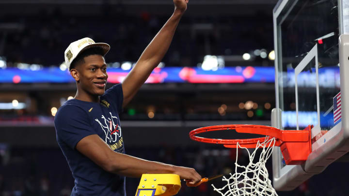 MINNEAPOLIS, MINNESOTA – APRIL 08: De'Andre Hunter #12 of the Virginia Cavaliers cuts down the net after his win over the Texas Tech Red Raiders in the 2019 National Championship game (Photo by Tom Pennington/Getty Images)