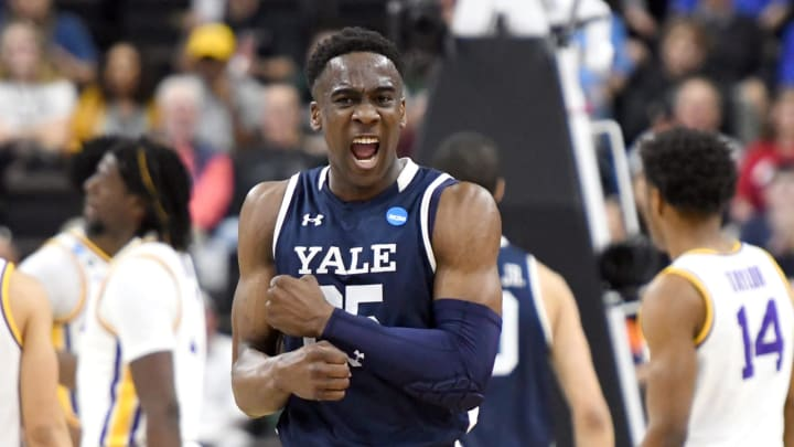 JACKSONVILLE, FL – MARCH 21: Miye Oni #25 of the Yale Bulldogs celebrates a shot during the First Round of the NCAA Basketball Tournament against the LSU Tigers (Photo by Mitchell Layton/Getty Images)
