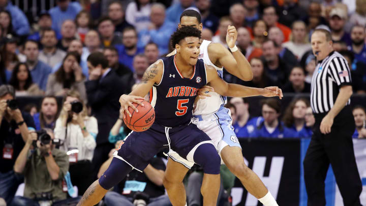 KANSAS CITY, MISSOURI – MARCH 29: Potential San Antonio Spurs prospect Chuma Okeke #5 of the Auburn Tigers handles the ball against Garrison Brooks #15 of the North Carolina Tar Heels during the 2019 NCAA Basketball Tournament Midwest Regional at Sprint Center on March 29, 2019 in Kansas City, Missouri. (Photo by Christian Petersen/Getty Images)