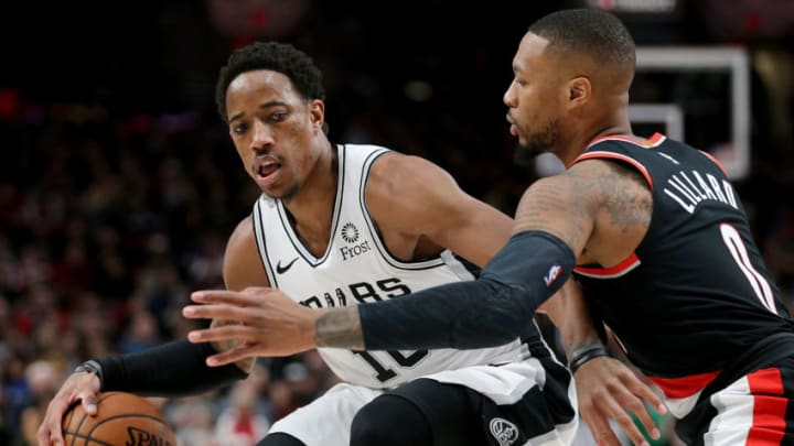 PORTLAND, OR - FEBRUARY 07: DeMar DeRozan #10 of the San Antonio Spurs dribbles against Damian Lillard #0 of the Portland Trail Blazers in the second quarter during their game at Moda Center on February 7, 2019 in Portland, Oregon. NOTE TO USER: User expressly acknowledges and agrees that, by downloading and or using this photograph, User is consenting to the terms and conditions of the Getty Images License Agreement. (Photo by Abbie Parr/Getty Images)