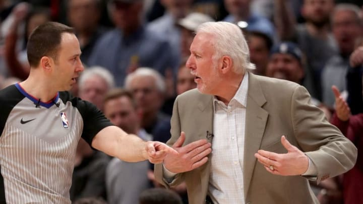 DENVER, COLORADO - APRIL 16: Head coach Gregg Popovich of the San Antonio Spurs argues with James Capers #19 before receiving a technical while playing the Denver Nuggets in the fourth quarter during game two of the first round of the NBA Playoffs at the Pepsi Center on April 16, 2019 in Denver, Colorado. NOTE TO USER: User expressly acknowledges and agrees that, by downloading and or using this photograph, User is consenting to the terms and conditions of the Getty Images License Agreement. (Photo by Matthew Stockman/Getty Images)