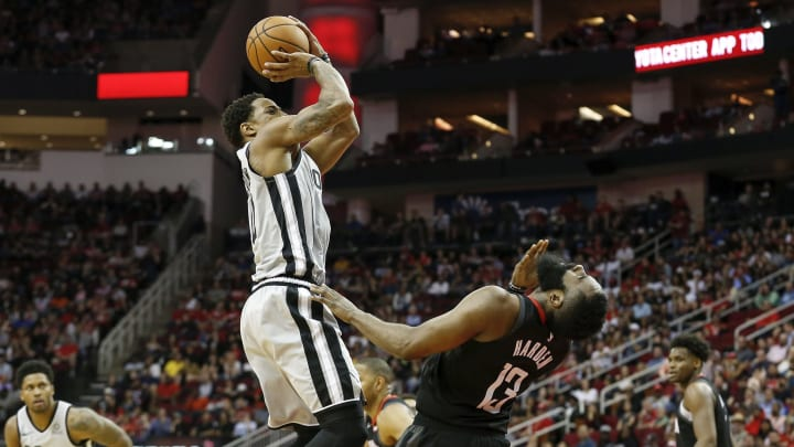 HOUSTON, TX – MARCH 22: DeMar DeRozan #10 of the San Antonio Spurs is called for an offensive foul defended by James Harden #13 of the Houston Rockets (Photo by Tim Warner/Getty Images)