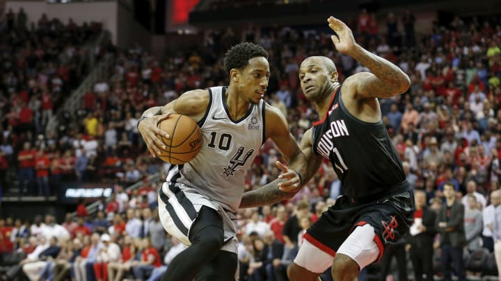San Antonio Spurs shooting guard DeMar DeRozan drives to the basket against small forward P.J. Tucker of the Houston Rockets at the Toyota Center (Photo by Tim Warner/Getty Images)