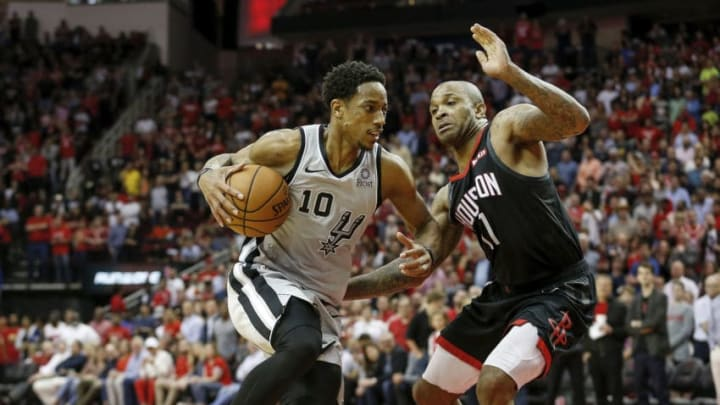 San Antonio Spurs shooting guard DeMar DeRozan drives to the basket against P.J. Tucker of the Houston Rockets (Photo by Tim Warner/Getty Images)