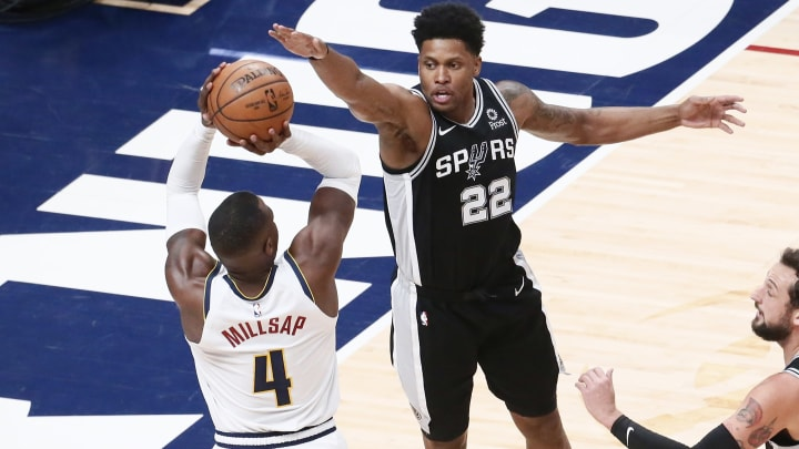 DENVER, CO – APRIL 16: Rudy Gay #22 of the San Antonio Spurs blocks a shot against Paul Millsap #4 of the Denver Nuggets during Game Two of Round One of the 2019 NBA Playoffs (Photo by Chris Elise/NBAE via Getty Images)