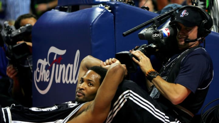 San Antonio Spurs forward Robert Horry leans up against a cameraman during Game Five of the 2005 NBA Finals in Detroit (Photo by Ronald Martinez/Getty Images)
