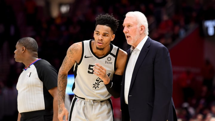 CLEVELAND, OHIO – MARCH 08: Dejounte Murray #5 listens to Head coach Gregg Popovich of the San Antonio Spurs during overtime against the Cleveland Cavaliers at Rocket Mortgage Fieldhouse. (Photo by Jason Miller/Getty Images)