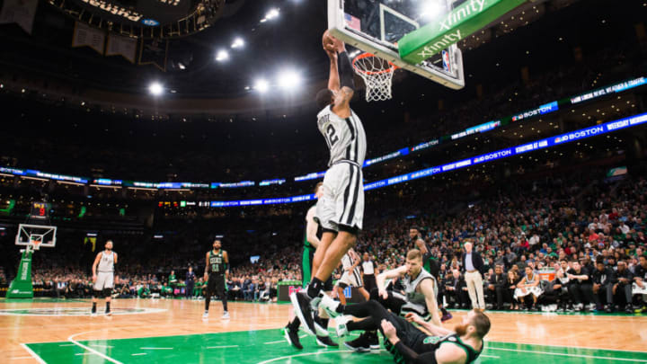 BOSTON, MA - MARCH 24: LaMarcus Aldridge #12 of the San Antonio Spurs dunks against Aron Baynes #46 of the Boston Celtics at TD Garden on March 24, 2019 in Boston, Massachusetts. NOTE TO USER: User expressly acknowledges and agrees that, by downloading and or using this photograph, User is consenting to the terms and conditions of the Getty Images License Agreement. (Photo by Kathryn Riley/Getty Images)