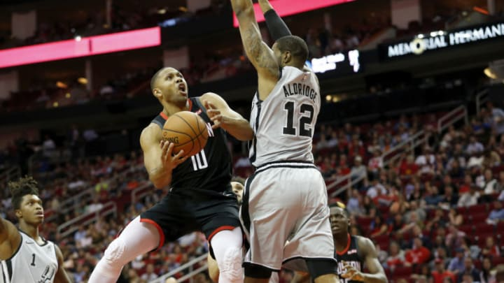 HOUSTON, TX - MARCH 22: Eric Gordon #10 of the Houston Rockets goes up for a shot defended by LaMarcus Aldridge #12 of the San Antonio Spurs in the first half at Toyota Center on March 22, 2019 in Houston, Texas. NOTE TO USER: User expressly acknowledges and agrees that, by downloading and or using this photograph, User is consenting to the terms and conditions of the Getty Images License Agreement. (Photo by Tim Warner/Getty Images)