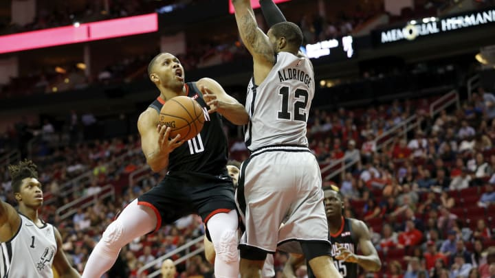 HOUSTON, TX – MARCH 22: Eric Gordon #10 of the Houston Rockets goes up for a shot defended by LaMarcus Aldridge #12 of the San Antonio Spurs in the first half at Toyota Center. (Photo by Tim Warner/Getty Images)