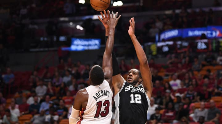 MIAMI, FLORIDA - OCTOBER 08: LaMarcus Aldridge #12 of the San Antonio Spurs shoots the ball over Bam Adebayo #13 of the Miami Heat during the first half of the preseason game at American Airlines Arena on October 08, 2019 in Miami, Florida. NOTE TO USER: User expressly acknowledges and agrees that, by downloading and or using this photograph, User is consenting to the terms and conditions of the Getty Images License Agreement. (Photo by Mark Brown/Getty Images)