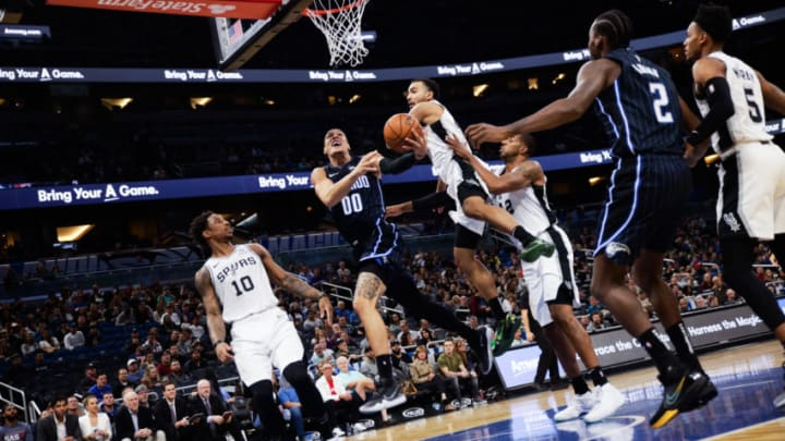 ORLANDO, FLORIDA - NOVEMBER 15: Aaron Gordon #00 of the Orlando Magic attempts to score against the defense of the San Antonio Spurs in the first quarter at Amway Center on November 15, 2019 in Orlando, Florida. NOTE TO USER: User expressly acknowledges and agrees that, by downloading and/or using this photograph, user is consenting to the terms and conditions of the Getty Images License Agreement. (Photo by Harry Aaron/Getty Images) (Photo by Harry Aaron/Getty Images)