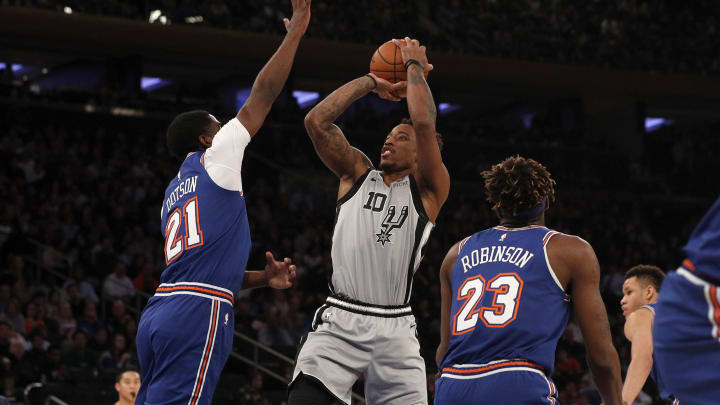 NEW YORK, NEW YORK – NOVEMBER 23: DeMar DeRozan #10 of the San Antonio Spurs shoots over Damyean Dotson #21 of the New York Knicks at Madison Square Garden. (Photo by Jim McIsaac/Getty Images)