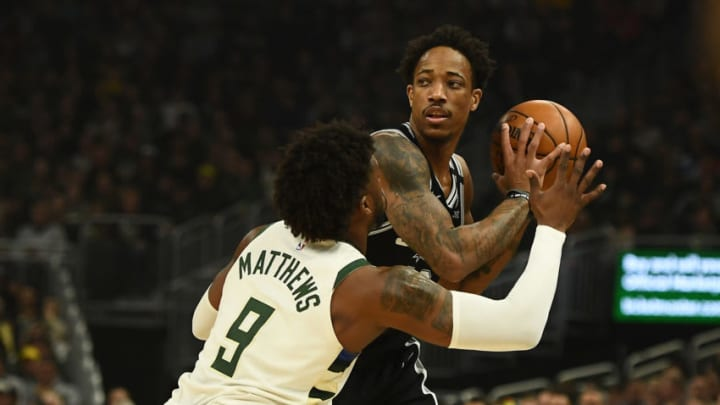 MILWAUKEE, WISCONSIN - JANUARY 04: DeMar DeRozan #10 of the San Antonio Spurs is defended by Wesley Matthews #9 of the Milwaukee Bucks during the first half of a game at Fiserv Forum on January 04, 2020 in Milwaukee, Wisconsin. NOTE TO USER: User expressly acknowledges and agrees that, by downloading and or using this photograph, User is consenting to the terms and conditions of the Getty Images License Agreement. (Photo by Stacy Revere/Getty Images)