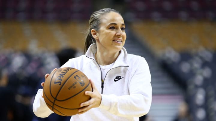TORONTO, ON - JANUARY 12: Assistant Coach Becky Hammon of the San Antonio Spurs passes the ball during warm up for an NBA game against the Toronto Raptors at Scotiabank Arena on January 12, 2020 in Toronto, Canada. NOTE TO USER: User expressly acknowledges and agrees that, by downloading and or using this photograph, User is consenting to the terms and conditions of the Getty Images License Agreement. (Photo by Vaughn Ridley/Getty Images)
