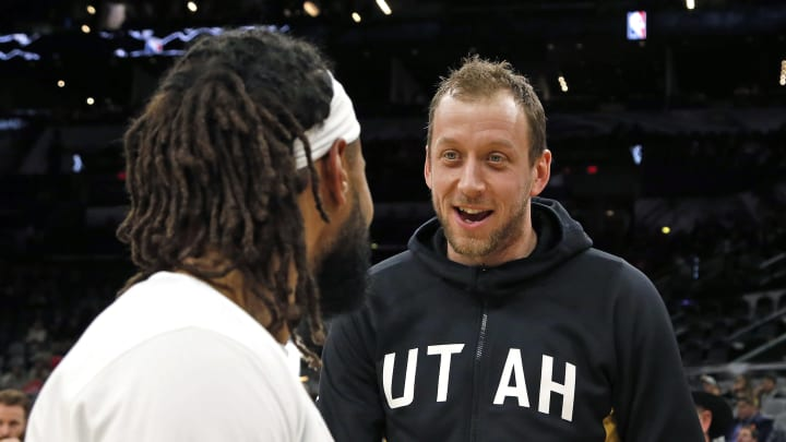 SAN ANTONIO, TX – JANUARY 29: Joe Ingles #2 of the Utah Jazz talks with Patty Mills #8 of the San Antonio Spurs before the start of the game at AT&T Center. (Photo by Ronald Cortes/Getty Images)