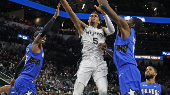 SAN ANTONIO, TX – FEBRUARY 29: Dejounte Murray #5 of the San Antonio Spurs drives between two Orlando Magic defenders during second half action at AT&T Center. (Photo by Ronald Cortes/Getty Images)