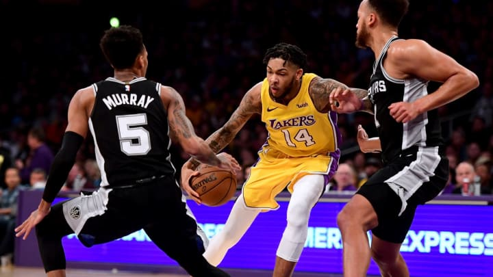 LOS ANGELES, CA – JANUARY 11: Brandon Ingram #14 of the Los Angeles Lakers drives to the basket on Dejounte Murray #5of the San Antonio Spurs at Staples Center on January 11, 2018. (Photo by Harry How/Getty Images)