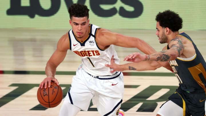 LAKE BUENA VISTA, FLORIDA – AUGUST 03: Michael Porter Jr. #1 of the Denver Nuggets handles the ball against Abdel Nader #11 of the Oklahoma City Thunder. (Photo by Kim Klement-Pool/Getty Images)