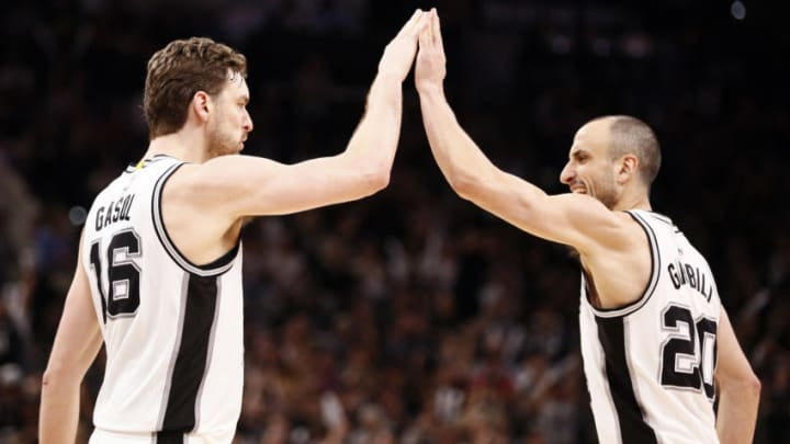Apr 25, 2017; San Antonio, TX, USA; San Antonio Spurs center Pau Gasol (16) celebrates a score with teammate Manu Ginobili (20) after scoring during the second half in game five of the first round of the 2017 NBA Playoffs against the Memphis Grizzlies at AT&T Center. Mandatory Credit: Soobum Im-USA TODAY Sports