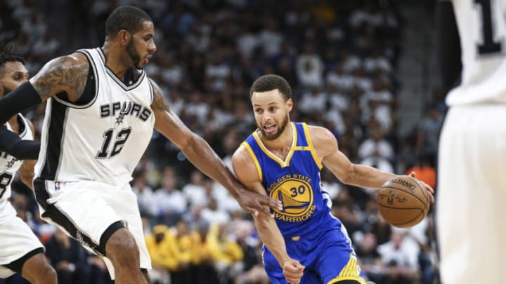 May 20, 2017; San Antonio, TX, USA; Golden State Warriors guard Stephen Curry (30) dribbles the ball as San Antonio Spurs forward LaMarcus Aldridge (12) defends during the third quarter in game three of the Western conference finals of the NBA Playoffs at AT&T Center. Mandatory Credit: Troy Taormina-USA TODAY Sports